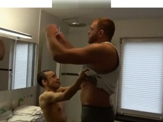 Giant muscle man shower with tiny small guy