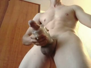 Young guy uses a sleeve masturbator toy to get orgasm and cum massive