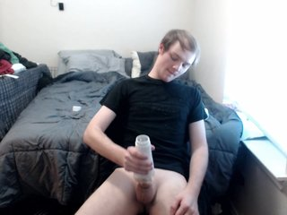 Twink uses toys and cums all over his shirt