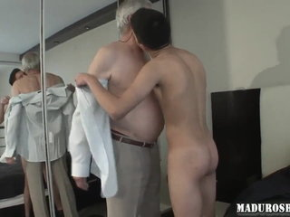 Mature businessman sex with young man