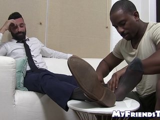 Bearded gentleman in suit enjoys interracial foot worshiping