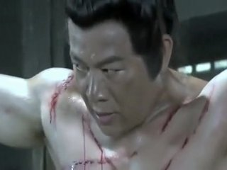 Shirtless muscular Chinese man being whipped
