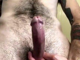Stroking oiled cock to HUGE cumshot